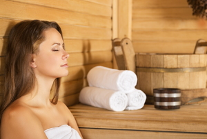 Woman sitting in a sauna