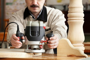 Man working with a router