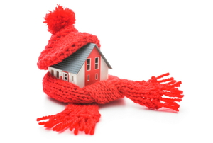 A house wrapped in a red scarf and hat.