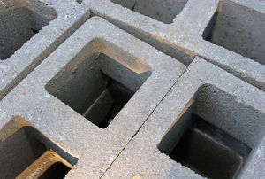 A cluster of cinder blocks sitting on top of one another.