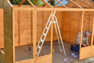 Framing a shed.