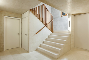 white concrete stairs descending into a lower room