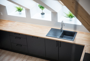 Black sink in long butcher block countertop