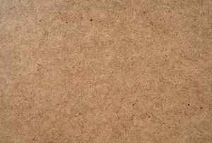 A close-up of hardboard texture.