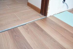 Wood floor meeting into tile floor in a doorway