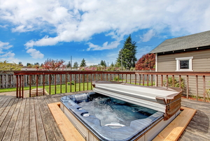 hot tub on a deck with cover folded back