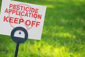 Pesticide sign on grass
