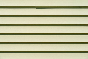 green painted vinyl siding