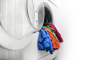 Clothes coming out of a dryer.