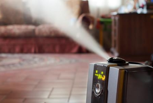 Humidifier spraying a mist into the room