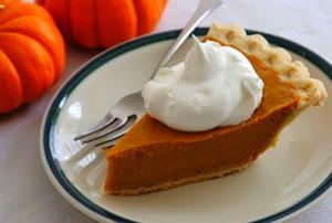 A slice of pumpkin pie on a plate.