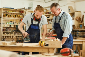 men in workshop making woodworking projects