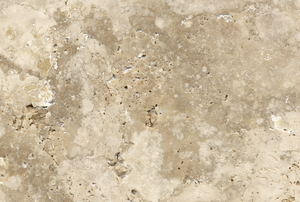A close-up of the texture of travertine tile.