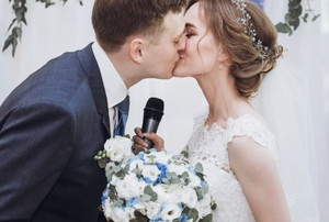 a husband and bride kiss at their wedding