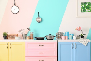 A yellow, pink and blue kitchen.