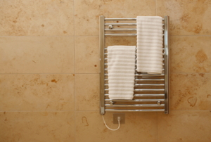 Towel warmer with two towels on it.