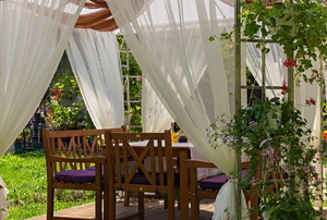 pergola with billowing curtains