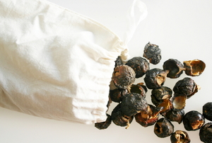 A white cloth bag with soap nuts.