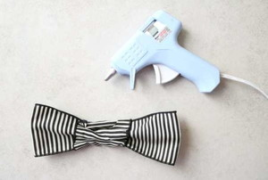 craft glue gun laying next to a bow tie