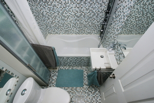 Aerial view of bathroom with teal accents