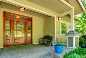 front porch with a stained fiberglass door