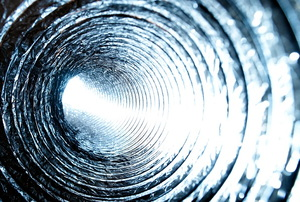 A close-up photo of the inside of a heating duct.