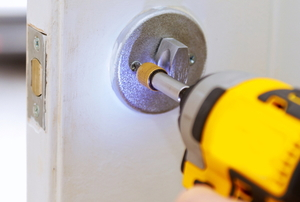 Installing a deadbolt with a power tool
