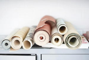 rolls of wallpaper in a pile