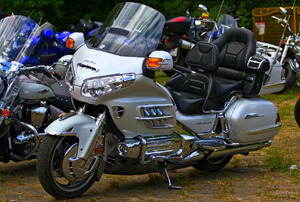 A silver Honda Goldwing in a motorcycle parking lot.