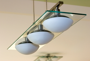 A modern light fixture hanging from the ceiling