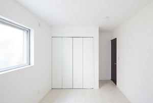 A closet with bi fold doors.
