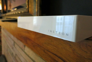 The Insteon hub on a living room mantle.