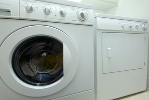 white washing machine and dryer in laundry room