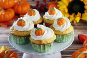 A cupcake stand with Thanksgiving cupcakes.