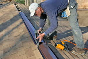 Man installing a roof ridge vent