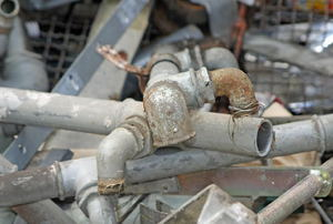 A pile of old rusty pipes.