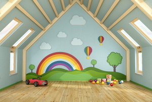 An attic playroom with a mural.