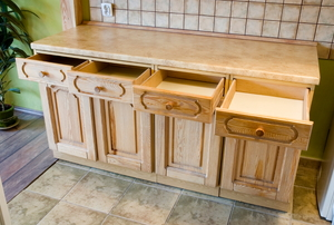 Set of wooden cabinets with open drawers