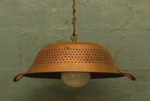 A repurposed copper colander made into a light.