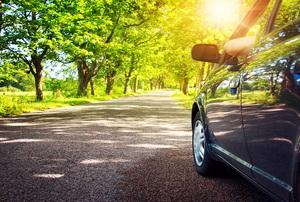 car driving in summer sun