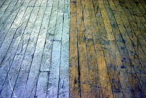 A wooden floor made from two different-colored types of board.