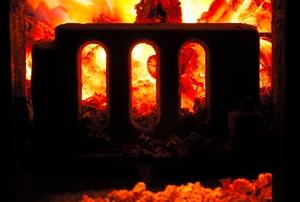 Part of a furnace heats up a home.