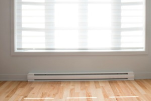 A baseboard heater painted white.