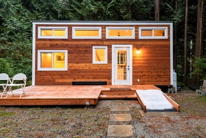 stylish wooden tiny home in a forest setting