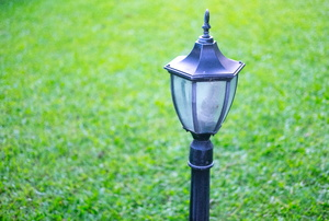 Lamp post with grass in the background