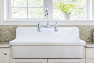 white kitchen sink and white cabinets