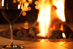 glass of red wine on a fire pit table