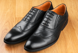 A pair of men's leather shoes in good condition.