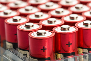 A bunch of red batteries.