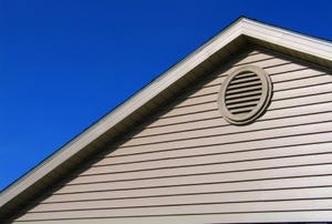 An exterior view of an attic vent.